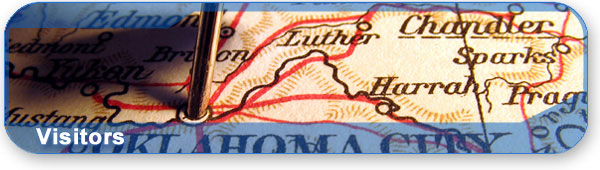 Visitors section banner with a photo of a map of Oklahoma City.